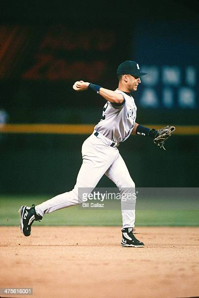 American League All-Star Derek Jeter of the New York Yankees throws the ball to first base during the 1998 All-Star Game at Coors Field on July 6,...