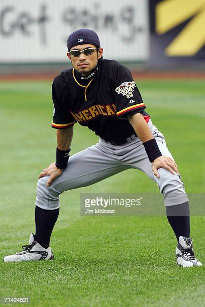 American League All-Star Ichiro Suzuki of the Seattle Mariners warms up on the field before the start of the 77th MLB All-Star Game at PNC Park on...