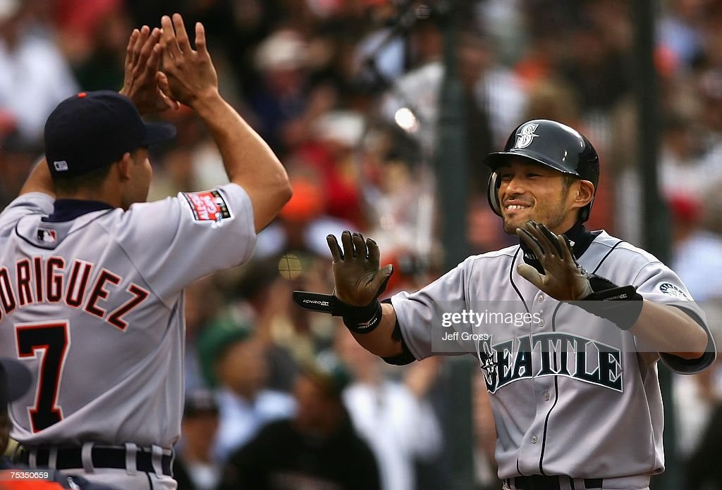 American League All-Star Ichiro Suzuki #51 of the Seattle Mariners celebrates with teammate Ivan Rodriguez #7 of the Detroit Tigers after Suzuki's inside the park home run in the fifth inning of the 78th Major League Baseball All-Star Game at AT&T Park on July 10, 2007 in San Francisco, California.