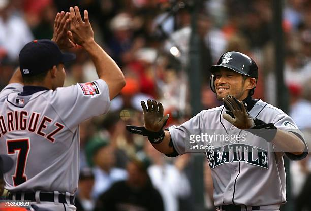 American League AllStar Ichiro Suzuki of the Seattle Mariners celebrates with teammate Ivan Rodriguez of the Detroit Tigers after Suzuki's inside the...
