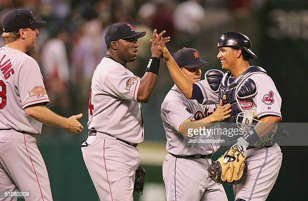 American League All-Star infielder David Ortiz of the Boston Red Sox high fives his fellow American League All-Star catcher Victor Martinez of the...