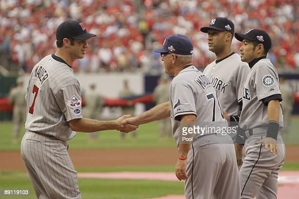 American League AllStar Joe Mauer of the Minnesota Twins greets manager Joe Madden of Tampa Bay Rays Derek Jeter of New York Yankees and Ichiro...