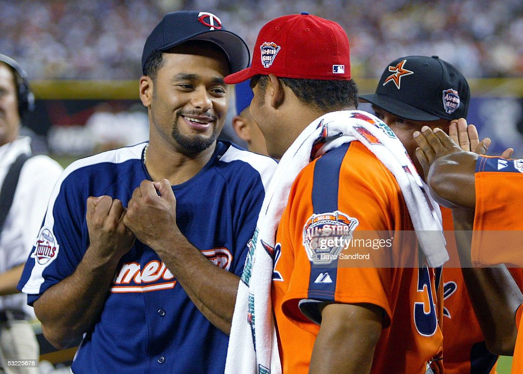 American League All-Star Johan Santana #57 of the Minnesota Twins talks with National League All-Star Bobby Abreu #53 of the Philadelphia Phillies during the 2005 Major League Baseball Home Run Derby at Comerica Park on July 11, 2005 in Detroit, Michigan.