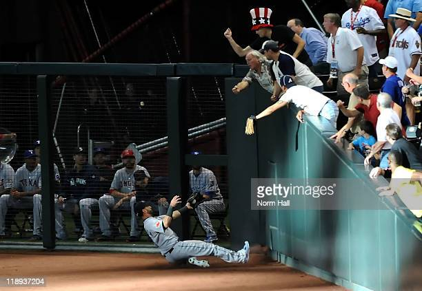 American League AllStar Jose Bautista of the Toronto Blue Jays makes a sliding catch in right field in the second inning of the 82nd MLB AllStar Game...