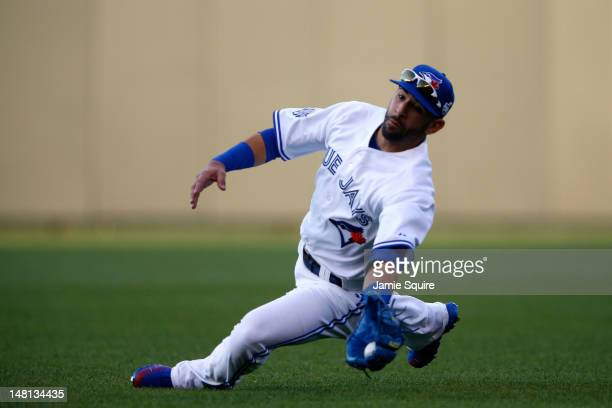 American League AllStar Jose Bautista of the Toronto Blue Jays makes a diving catch on a ball hit by National League AllStar Ryan Braun of the...