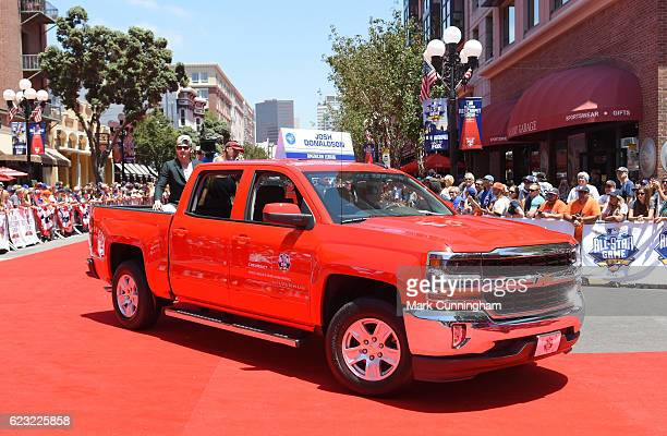 American League AllStar Josh Donaldson of the Toronto Blue Jays rides in the back of a Chevy truck in the 2016 Chevrolet AllStar Red Carpet Parade...