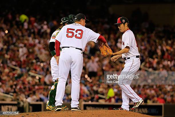 American League AllStar Manager John Farrell gives the ball to Koji Uehara against the National League AllStars during the 85th MLB AllStar Game at...