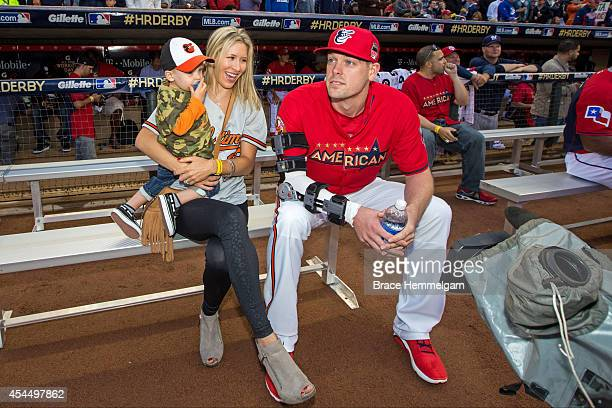 American League AllStar Matt Wieters of the Baltimore Orioles with his wife and son during the Gillette Home Run Derby at Target Field on July 14...