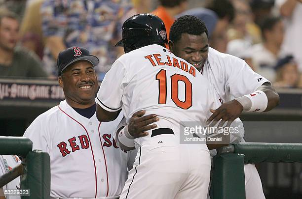 American League AllStar Miguel Tejada of the Baltimore Orioles is congratulated by David Ortiz of the Boston Red Sox and hitting coach Ron Jackson...