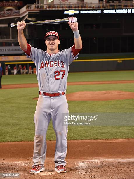 American League AllStar Mike Trout of the Los Angeles Angels of Anaheim poses for a photo with his Ted Williams Most Valuable Player trophy after the...