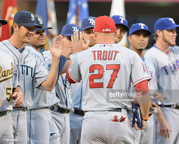 American League All-Star Mike Trout of the Los Angeles Angels of Anaheim gets congratulations from his teammates prior to the 84th MLB All-Star Game...