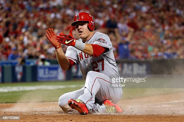 American League AllStar Mike Trout of the Los Angeles Angels of Anaheim celebrates after scoing off of American League AllStar Prince Fielder of the...