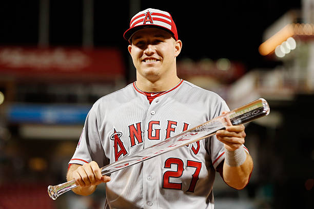American League All-Star Mike Trout of the Los Angeles Angels of Anaheim poses with the MVP trophy after defeating the National League 6 to 3 in the...