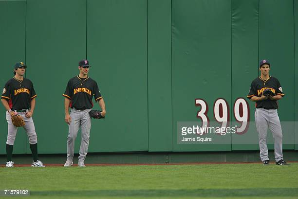 American League All-Star pitcher Barry Zito of the Oakland A's stands near catcher Joe Mauer of the Minnesota Twins and center fielder Grady Sizemore...