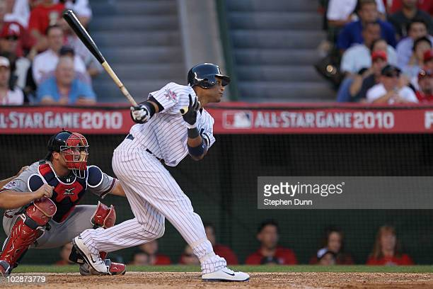 American League AllStar Robinson Cano of the New York Yankees hits a sacrifice fly to score American League AllStar Evan Longoria of the Tampa Bay...