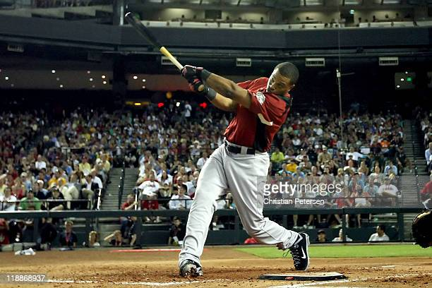 American League AllStar Robinson Cano of the New York Yankees hits during the final round of the 2011 State Farm Home Run Derby at Chase Field on...