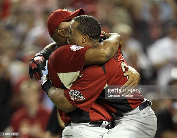 American League AllStar Robinson Cano of the New York Yankees hugs his father Jose after winning the 2011 State Farm Home Run Derby at Chase Field on...