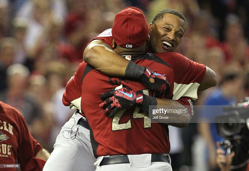 American League All-Star Robinson Cano #24 of the New York Yankees hugs his father Jose after winning the 2011 State Farm Home Run Derby at Chase Field on July 11, 2011 in Phoenix, Arizona. Cano won the 2011 State Farm Home Run Derby with a recond 12 home runs in the final round.