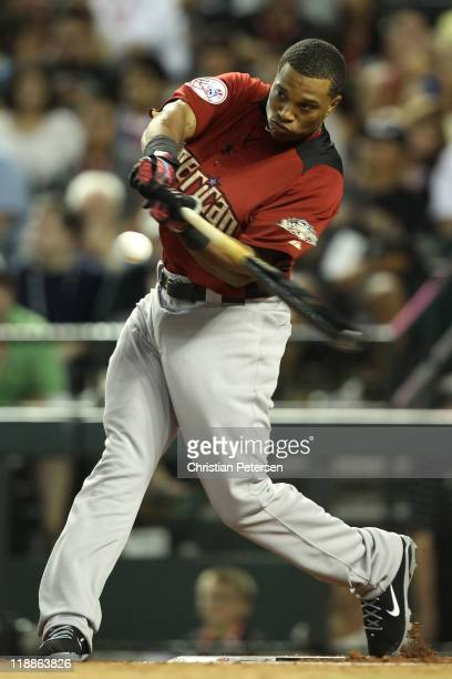 American League AllStar Robinson Cano of the New York Yankees participates in the second round of the 2011 State Farm Home Run Derby at Chase Field...
