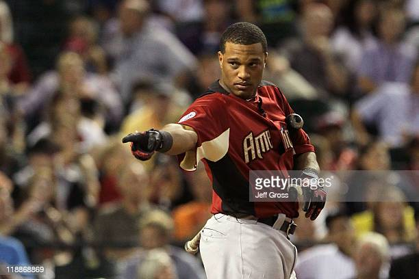 American League AllStar Robinson Cano of the New York Yankees looks on in the final round of the 2011 State Farm Home Run Derby at Chase Field on...