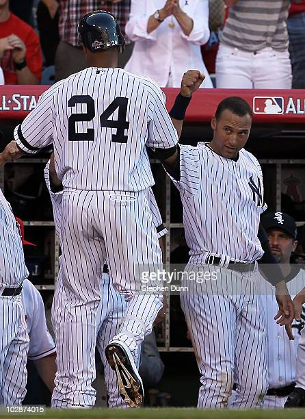American League AllStar Robinson Cano of the New York Yankees on his way into the dugout after hitting a sacrifice fly to score American League...