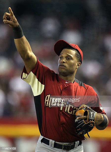d125f6ed1dd American League AllStar Robinson Cano of the New York Yankees points during  batting practice before the