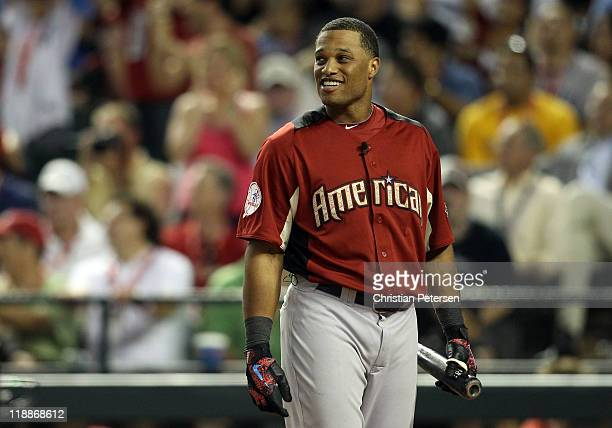 American League AllStar Robinson Cano of the New York Yankees reacts in the final round of the 2011 State Farm Home Run Derby at Chase Field on July...
