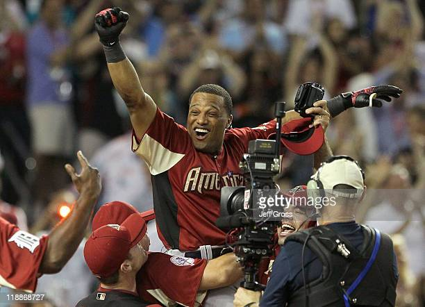 American League AllStar Robinson Cano of the New York Yankees reacts after winning the 2011 State Farm Home Run Derby at Chase Field on July 11 2011...