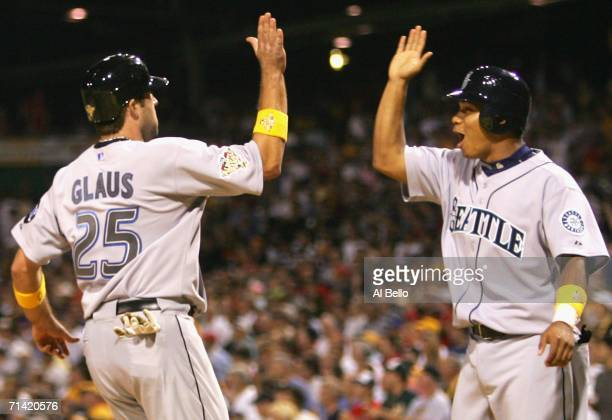 American League AllStar Troy Glaus of the Toronto Blue Jays is congratulated by Jose Lopez of the Seattle Mariners after scoring the winning run on a...