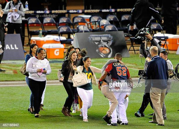 American League AllStar Yoenis Cespedes of the Oakland A's celebrates with his family after winning the Gillette Home Run Derby at Target Field on...