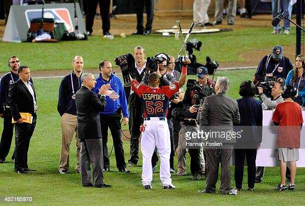 American League AllStar Yoenis Cespedes of the Oakland A's celebrates with the trophy after winning the Gillette Home Run Derby at Target Field on...