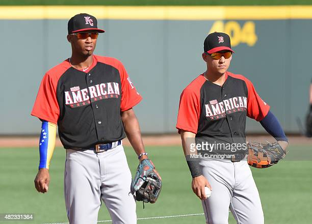 American League AllStars Alcides Escobar of the Kansas City Royals and Jose Iglesias of the Detroit Tigers look on during batting practice prior to...