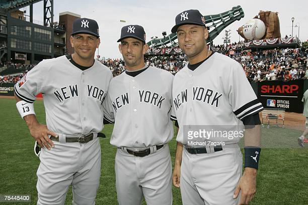 American League AllStars Alex Rodriguez Jorge Posada and Derek Jeter of the New York Yankees pose for a group photo before the 78th Major League...