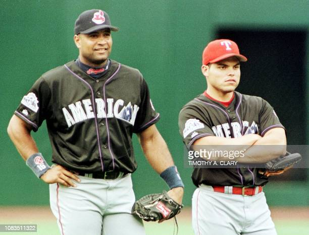 American League catchers Sandy Alomar Jr of the Cleveland Indians and Ivan Rodriguez of the Texas Rangers both of Puerto Rico watch batting practice...