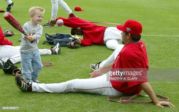 American League Champion Anaheim Angels Benji Gil plays catch with his son Mateo during practice at Edison Field 16 October 2002 the Angels are...