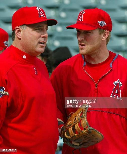 American League Champion Anaheim Angels manager Mike Scioscia talks to outfielder Darin Erstad during practice at Edison Field 17 October 2002 as...