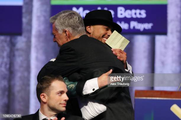 American League MVP Mookie Betts of the Boston Red Sox hugs President of Baseball Operations David Dombrowski during the 2019 Baseball Writers'...