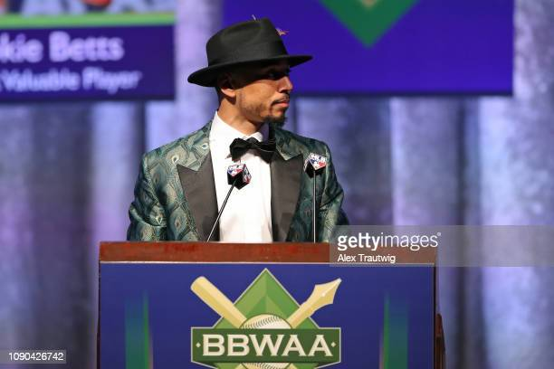 American League MVP Mookie Betts of the Boston Red Sox speaks during the 2019 Baseball Writers' Association of America awards dinner on Saturday...