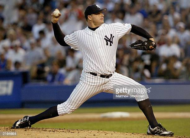 American League pitcher Roger Clemens from the New York Yankees throws against the National League in the third inning of the 74th Major League...