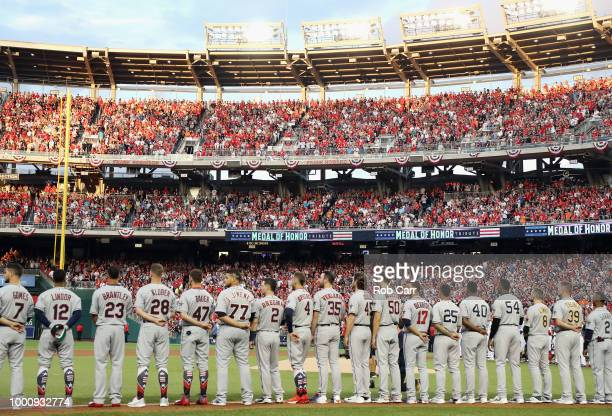 American League players look on during the national anthem before the 89th MLB AllStar Game presented by Mastercard at Nationals Park on July 17 2018...