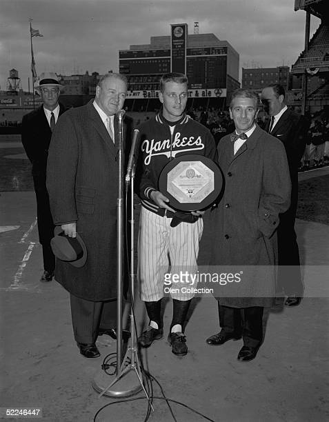 American League President Joe Cronin presents outfielder Roger Maris, of the New York Yankees, with the American league Most Valuable Player trophy...