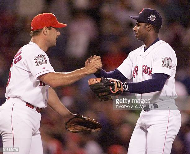 American League relief pitcher John Wetteland of the Texas Rangers shakes hands with Boston Red Sox second baseman Jose Offerman at the end of the...