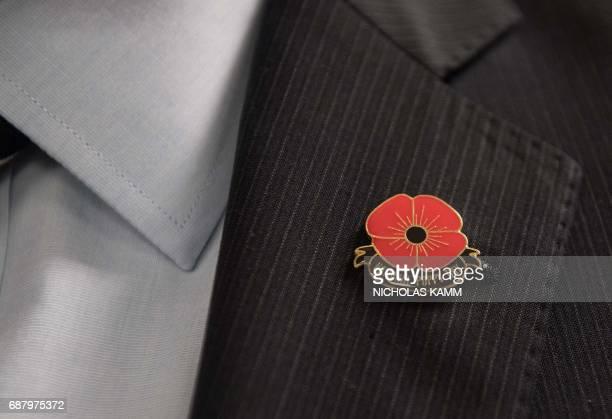 American Legion spokesman Joe Plenzler wears a National Poppy Day pin on his lapel at the Pentagon in Washington DC on May 22 2017 Long an...
