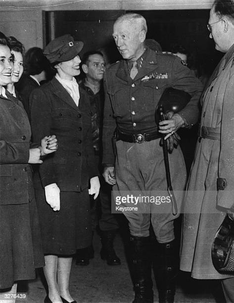 American Lieutenant General George Patton and Major General Manton Eddy chatting with Red Cross Helpers at the opening of the new Red Cross Club in...