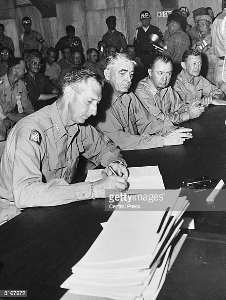 American Lieutenant General Mark Clark signing the Korean Armistice at Munsan, South Korea, July 27, 1953. While the armistice was negotiated at...