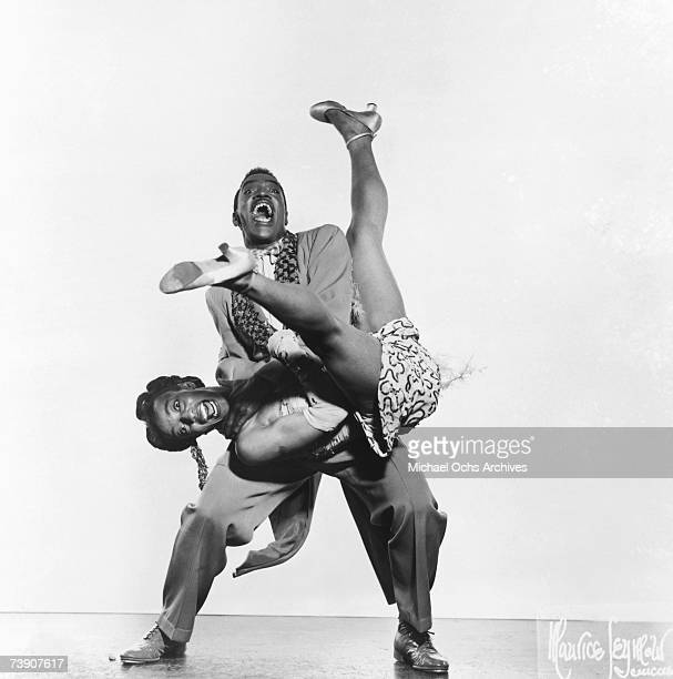 Jitterbug dancers Norma Miller and Billy Ricker of Norma Miller's Dancers performing with Irwin C Miller's Brown Skin Models Harlem Road Show pose...