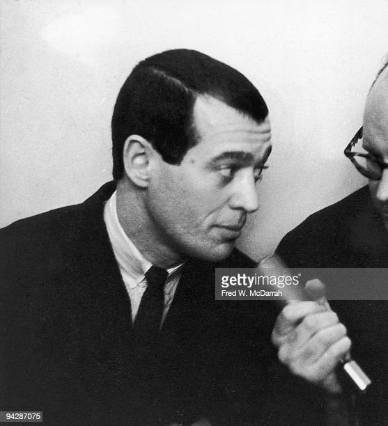 American literary critic and author Anatole Broyard speaks into a microphone during an event at the Living Theatre New York New York April 5 1960