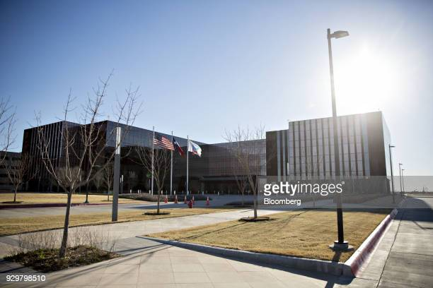 American Lone Star and Chevron Corp flags fly outside an office building in Midland Texas US on Thursday March 1 2018 Chevron the world's...