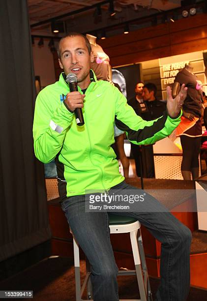 American longdistance runner Dathan Ritzenhein attends the Nike Run Club event at Nike Chicago on October 4 2012 in Chicago Illinois