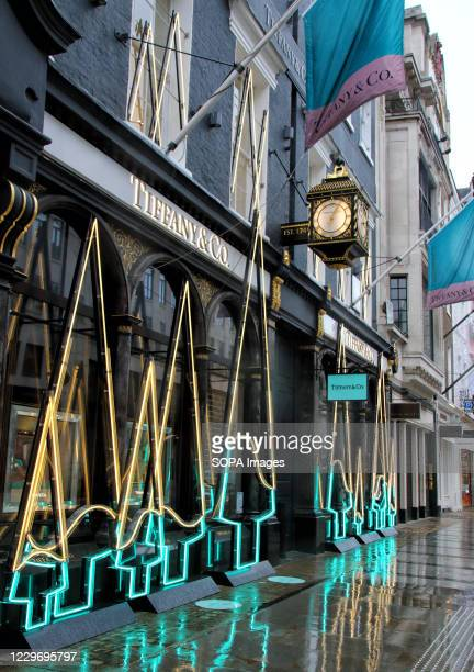 American luxury jewelry and specialty retailer, Tiffany & Co. Seen installed with neon lights in the shape of Christmas Trees outside their Old Bond...